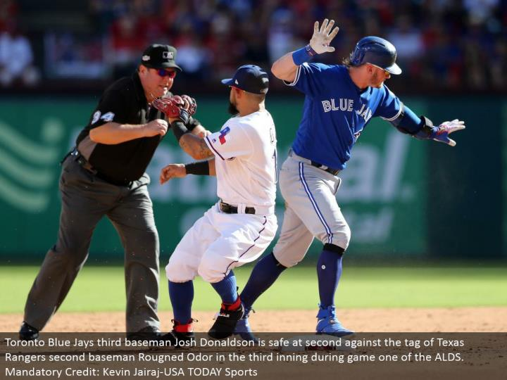Toronto Blue Jays third baseman Josh Donaldson is protected at second against the tag of Texas Rangers second baseman Rougned Odor in the third inning amid diversion one of the ALDS. Compulsory Credit: Kevin Jairaj-USA TODAY Sports