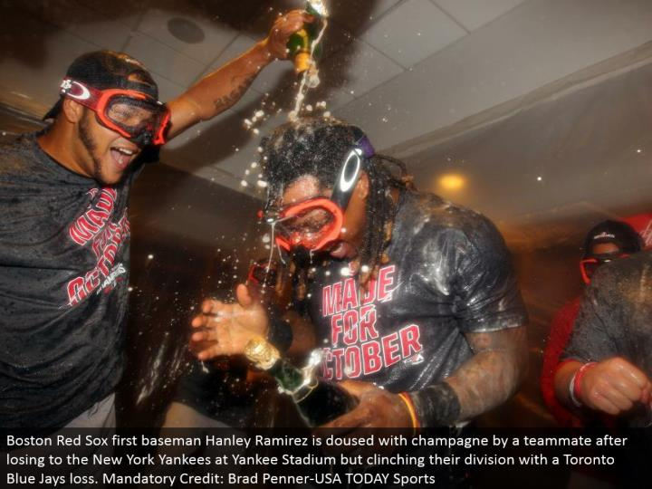 Boston Red Sox first baseman Hanley Ramirez is splashed with champagne by a partner subsequent to losing to the New York Yankees at Yankee Stadium however securing their division with a Toronto Blue Jays misfortune. Required Credit: Brad Penner-USA TODAY Sports