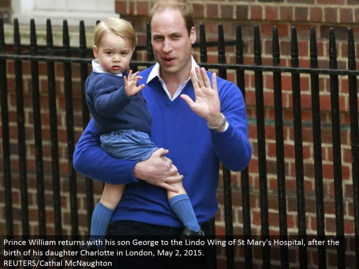 Prince William comes back with his child George to the Lindo Wing of St Mary's Hospital, after the introduction of his girl Charlotte in London, May 2, 2015. REUTERS/Cathal McNaughton