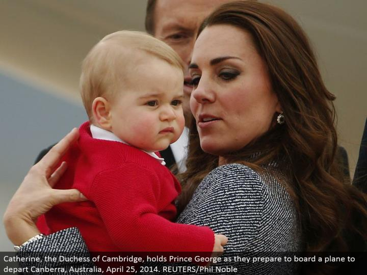 Catherine, the Duchess of Cambridge, holds Prince George as they get ready to load onto a plane to leave Canberra, Australia, April 25, 2014. REUTERS/Phil Noble
