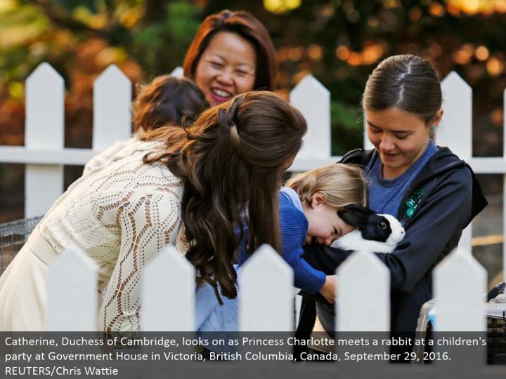 Catherine, Duchess of Cambridge, looks on as Princess Charlotte meets a rabbit at a youngsters' gathering at Government House in Victoria, British Columbia, Canada, September 29, 2016. REUTERS/Chris Wattie