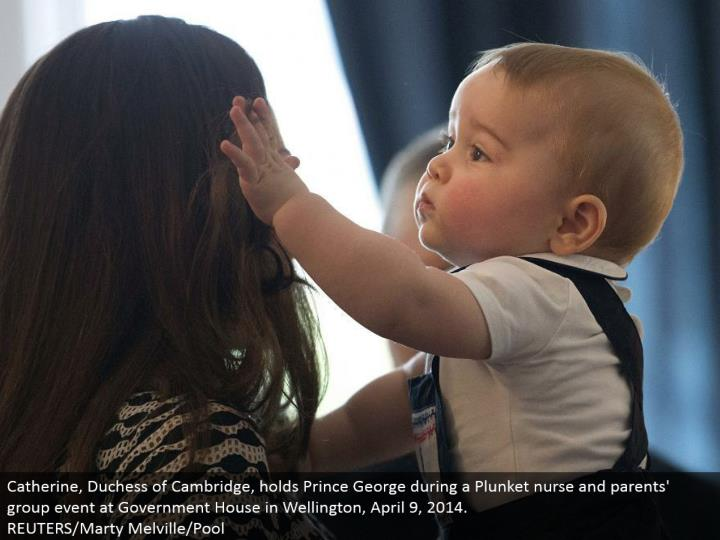 Catherine, Duchess of Cambridge, holds Prince George amid a Plunket attendant and guardians' gathering occasion at Government House in Wellington, April 9, 2014. REUTERS/Marty Melville/Pool