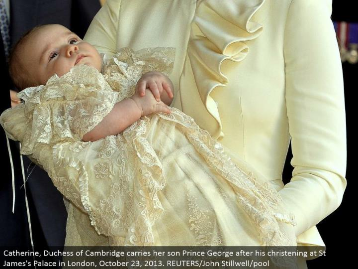 Catherine, Duchess of Cambridge conveys her child Prince George after his dedicating at St James' Palace in London, October 23, 2013. REUTERS/John Stillwell/pool