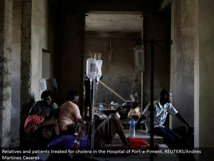 Relatives and patients treated for cholera in the Hospital of Port-a-Piment. REUTERS/Andres Martinez Casares