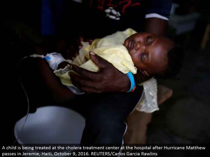 A kid is being dealt with at the cholera treatment focus at the healing center after Hurricane Matthew goes in Jeremie, Haiti, October 9, 2016. REUTERS/Carlos Garcia Rawlins