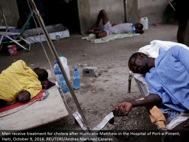 Men get treatment for cholera after Hurricane Matthew in the Hospital of Port-a-Piment, Haiti, October 9, 2016. REUTERS/Andres Martinez Casares
