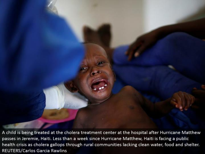A youngster is being dealt with at the cholera treatment focus at the healing center after Hurricane Matthew goes in Jeremie, Haiti. Not exactly a week since Hurricane Matthew, Haiti is confronting a general wellbeing emergency as cholera jogs through rustic groups lacking clean water, sustenance and asylum.  REUTERS/Carlos Garcia Rawlins
