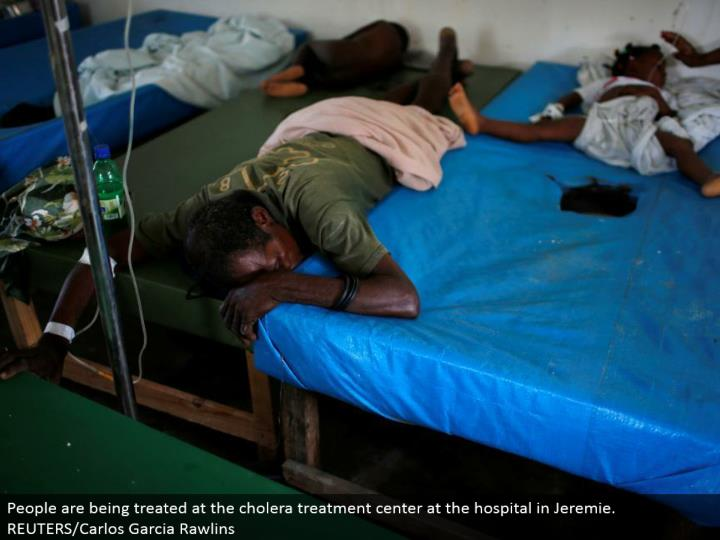 People are being dealt with at the cholera treatment focus at the healing facility in Jeremie. REUTE...