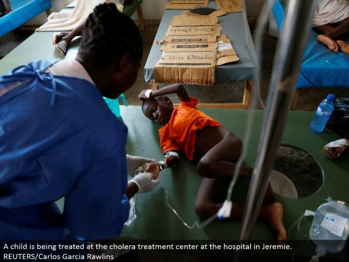 A tyke is being dealt with at the cholera treatment focus at the healing facility in Jeremie. REUTERS/Carlos Garcia Rawlins