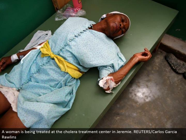 A lady is being dealt with at the cholera treatment focus in Jeremie. REUTERS/Carlos Garcia Rawlins