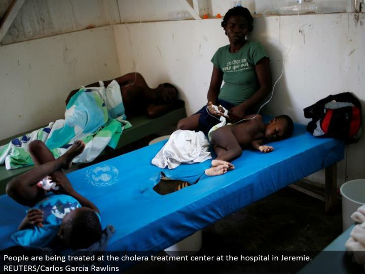 People are being dealt with at the cholera treatment focus at the healing facility in Jeremie. REUTERS/Carlos Garcia Rawlins