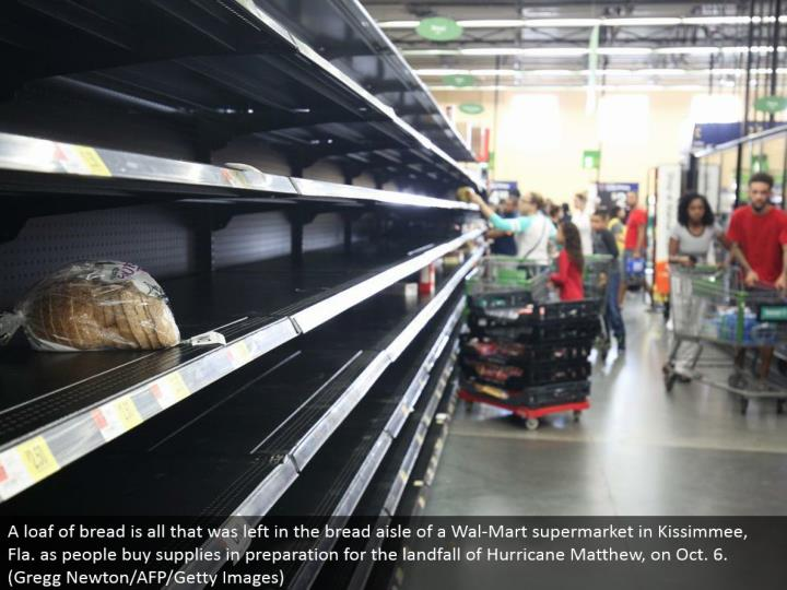 A piece of bread is every one of that was left in the bread path of a Wal-Mart market in Kissimmee, Fla. as individuals purchase supplies in readiness for the landfall of Hurricane Matthew, on Oct. 6. (Gregg Newton/AFP/Getty Images)