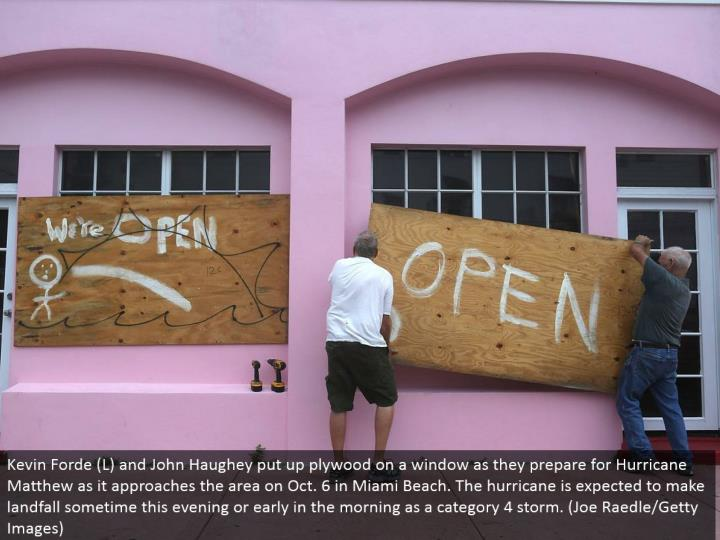 Kevin Forde (L) and John Haughey set up plywood on a window as they plan for Hurricane Matthew as it methodologies the territory on Oct. 6 in Miami Beach. The typhoon is required to make landfall at some point tonight or at a young hour in the morning as a classification 4 storm. (Joe Raedle/Getty Images)