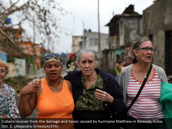 Cubans recuperate from the harm and devastation brought on by storm Matthew in Baracoa, Cuba, Oct. 5. (Alejandro ErnestoA/EPA)