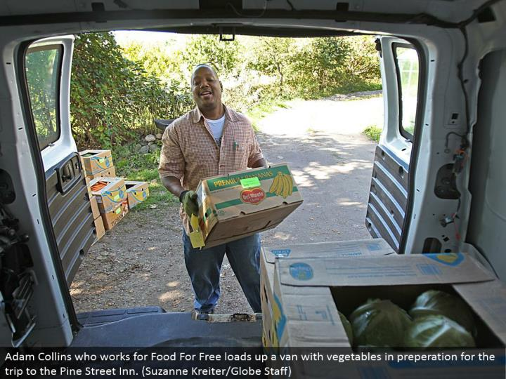 Adam Collins who works for Food For Free loads up a van with vegetables in preperation for the trek to the Pine Street Inn. (Suzanne Kreiter/Globe Staff)