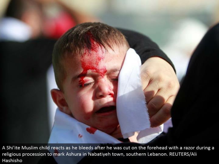A Shi'ite Muslim tyke responds as he seeps after he was cut on the brow with a razor amid a religious parade to check Ashura in Nabatiyeh town, southern Lebanon. REUTERS/Ali Hashisho