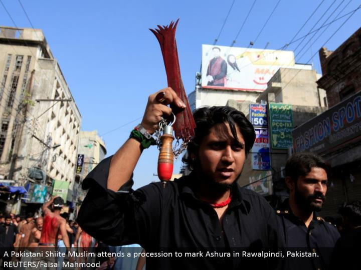 A Pakistani Shiite Muslim goes to a parade to stamp Ashura in Rawalpindi, Pakistan. REUTERS/Faisal Mahmood