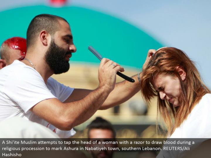A Shi'ite Muslim endeavors to tap the leader of a lady with a razor to draw blood amid a religious parade to check Ashura in Nabatiyeh town, southern Lebanon. REUTERS/Ali Hashisho