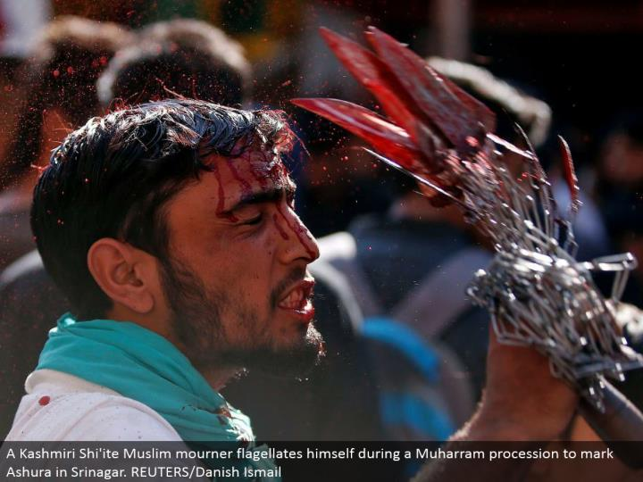 A Kashmiri Shi'ite Muslim griever beats himself amid a Muharram parade to stamp Ashura in Srinagar. REUTERS/Danish Ismail