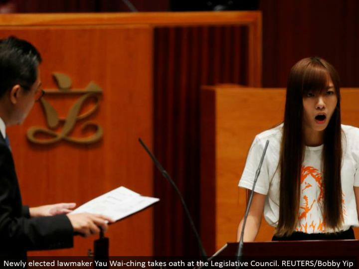 Newly chose administrator Yau Wai-ching takes vow at the Legislative Council. REUTERS/Bobby Yip