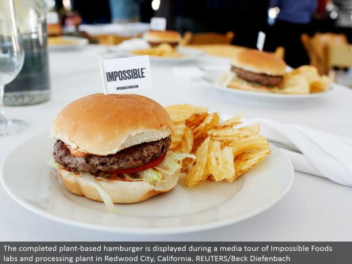 The finished plant-based burger is shown amid a media voyage through Impossible Foods labs and preparing plant in Redwood City, California. REUTERS/Beck Diefenbach