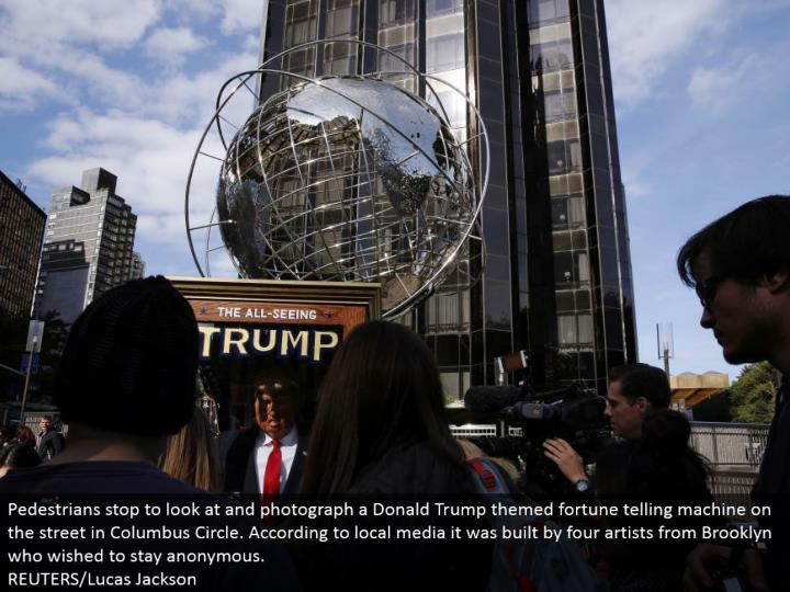 Pedestrians stop to take a gander at and photo a Donald Trump themed fortune telling machine in the city in Columbus Circle. As indicated by neighborhood media it was worked by four craftsmen from Brooklyn who wished to stay unknown. REUTERS/Lucas Jackson