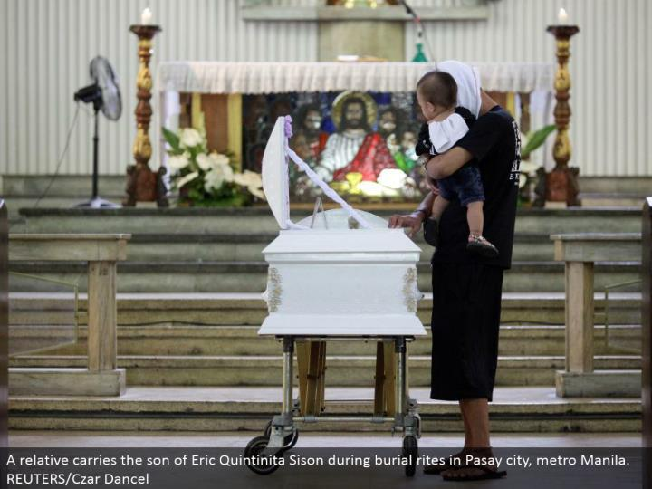 A relative conveys the child of Eric Quintinita Sison amid entombment customs in Pasay city, metro Manila. REUTERS/Czar Dancel