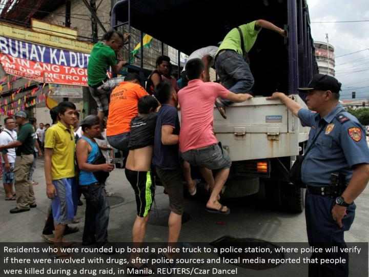 Residents who were gathered together board a police truck to a police headquarters, where police will check if there were included with medications, after police sources and neighborhood media reported that individuals were murdered amid a medication assault, in Manila. REUTERS/Czar Dancel