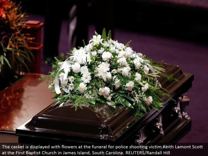 The coffin is shown with blooms at the burial service for police shooting casualty Keith Lamont Scott at the First Baptist Church in James Island, South Carolina. REUTERS/Randall Hill
