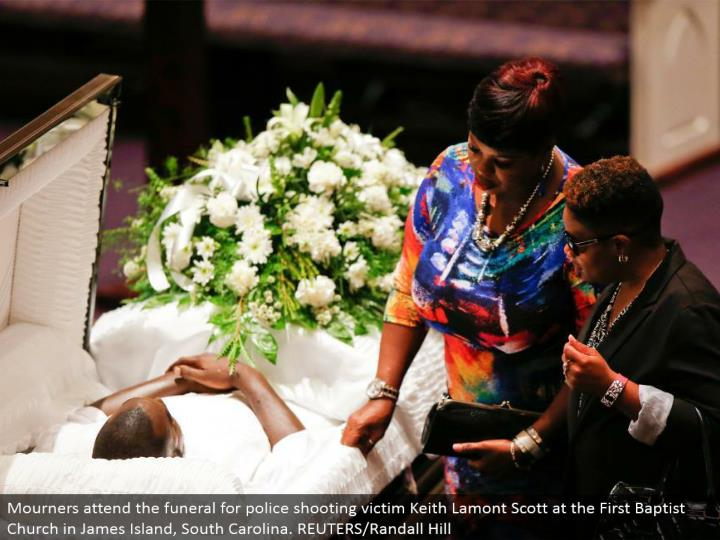 Mourners go to the burial service for police shooting casualty Keith Lamont Scott at the First Baptist Church in James Island, South Carolina. REUTERS/Randall Hill