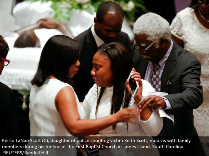 Keirra LaNae Scott (C), little girl of police shooting casualty Keith Scott, grieves with relatives amid his memorial service at the First Baptist Church in James Island, South Carolina. REUTERS/Randall Hill