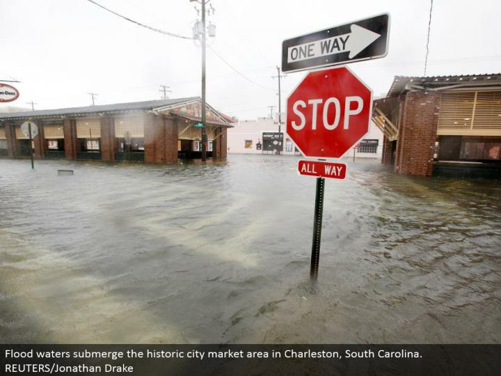Flood waters submerge the memorable city advertise territory in Charleston, South Carolina. REUTERS/Jonathan Drake