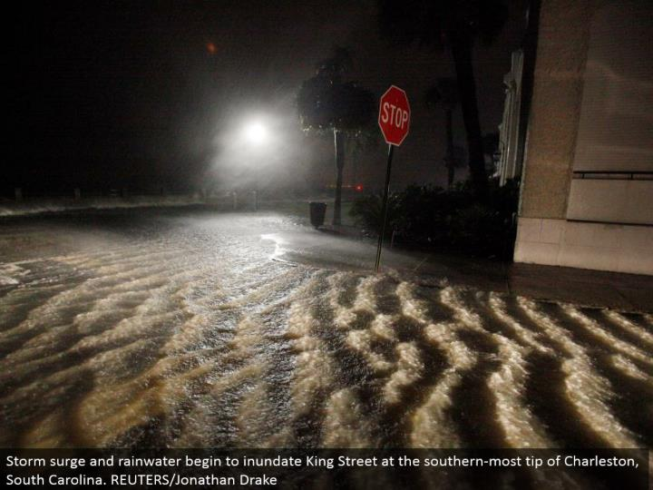 Storm surge and water start to immerse King Street at the southern-most tip of Charleston, South Carolina. REUTERS/Jonathan Drake