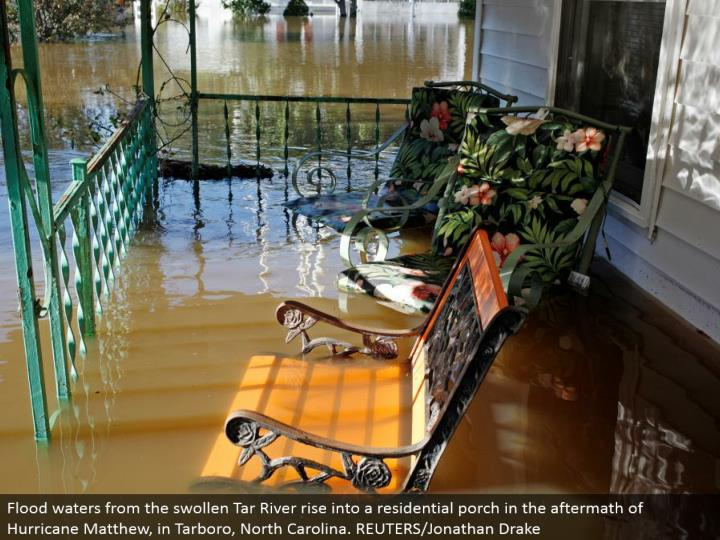 Flood waters from the swollen Tar River ascend into a private patio in the outcome of Hurricane Matthew, in Tarboro, North Carolina. REUTERS/Jonathan Drake