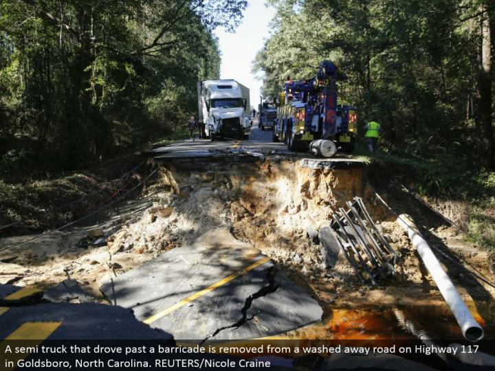 A semi truck that drove past a blockade is expelled from a washed away street on Highway 117 in Goldsboro, North Carolina. REUTERS/Nicole Craine