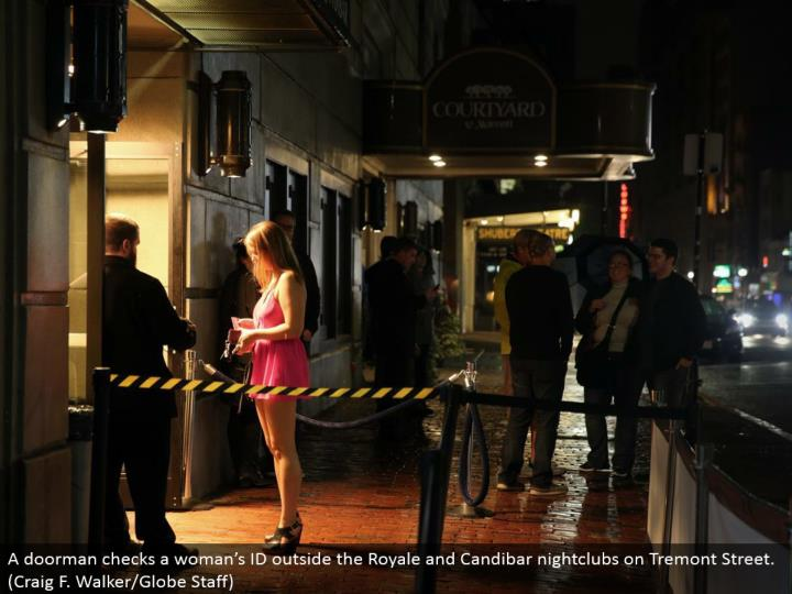 A concierge checks a lady's ID outside the Royale and Candibar dance club on Tremont Street. (Craig F. Walker/Globe Staff)