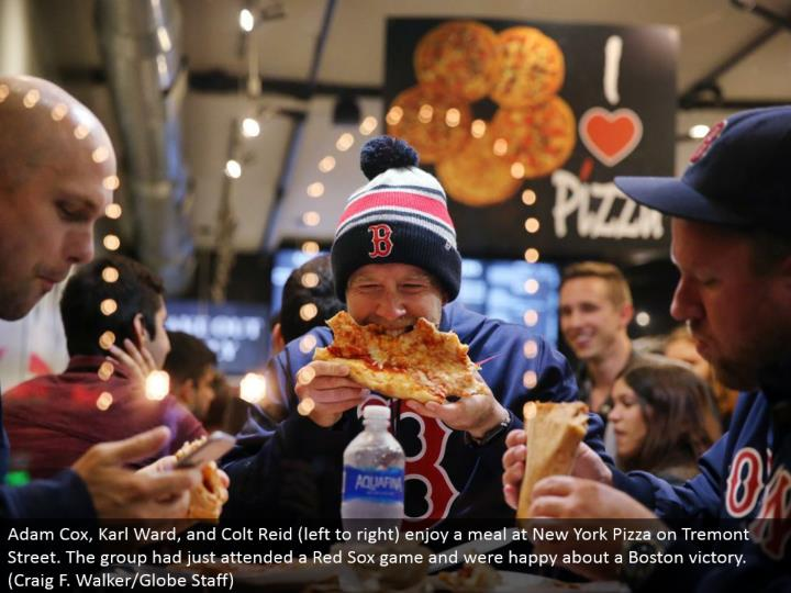 Adam Cox, Karl Ward, and Colt Reid (left to right) appreciate a feast at New York Pizza on Tremont Street. The gathering had quite recently gone to a Red Sox amusement and were cheerful around a Boston triumph. (Craig F. Walker/Globe Staff)