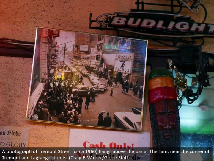 A photo of Tremont Street (around 1960) hangs over the bar at The Tam, close to the side of Tremont and Lagrange roads. (Craig F. Walker/Globe Staff)