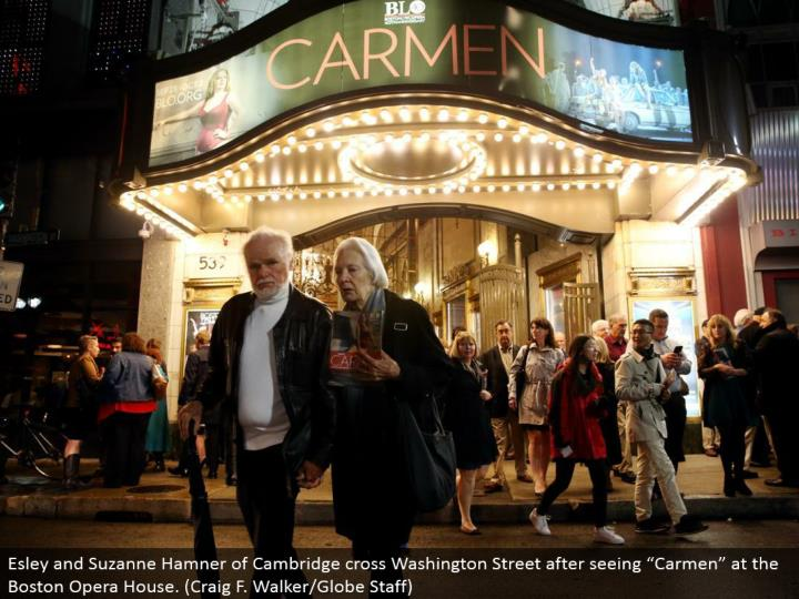"Esley and Suzanne Hamner of Cambridge cross Washington Street subsequent to seeing ""Carmen"" at the Boston Opera House. (Craig F. Walker/Globe Staff)"