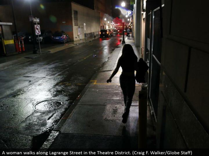 A lady strolls along Lagrange Street in the Theater District. (Craig F. Walker/Globe Staff)