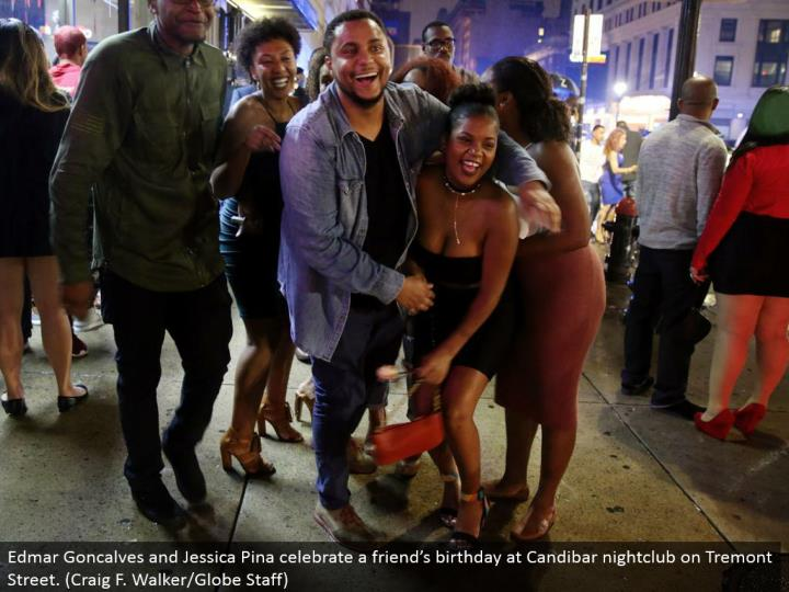 Edmar Goncalves and Jessica Pina commend a companion's birthday at Candibar dance club on Tremont Street. (Craig F. Walker/Globe Staff)