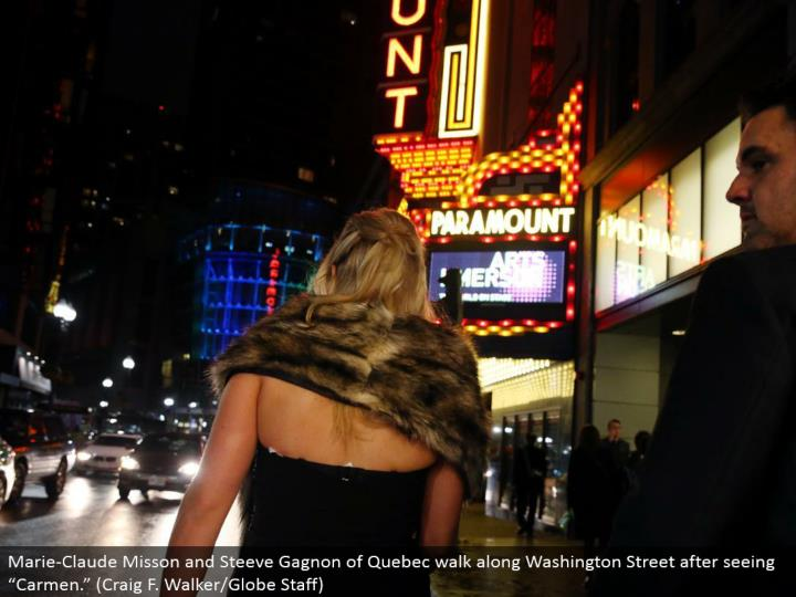 "Marie-Claude Misson and Steeve Gagnon of Quebec stroll along Washington Street in the wake of seeing ""Carmen."" (Craig F. Walker/Globe Staff)"