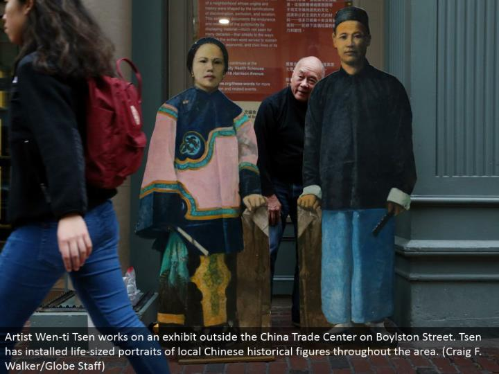 Artist Wen-ti Tsen chips away at a display outside the China Trade Center on Boylston Street. Tsen has introduced life-sized representations of neighborhood Chinese recorded figures all through the territory. (Craig F. Walker/Globe Staff)