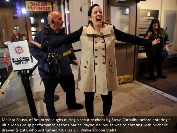 Melissa Sousa, of Braintree chuckles amid a security check by Steve Carbalho before entering a Blue Man Group execution at the Charles Playhouse. Sousa was celebrating with Michelle Brewer (right), who simply turned 40. (Craig F. Walker/Globe Staff)