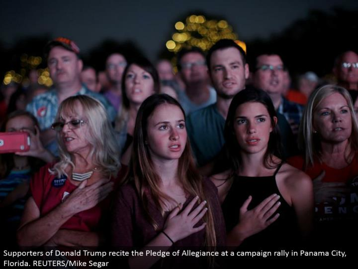 Supporters of Donald Trump present the Pledge of Allegiance at a crusade rally in Panama City, Florida. REUTERS/Mike Segar