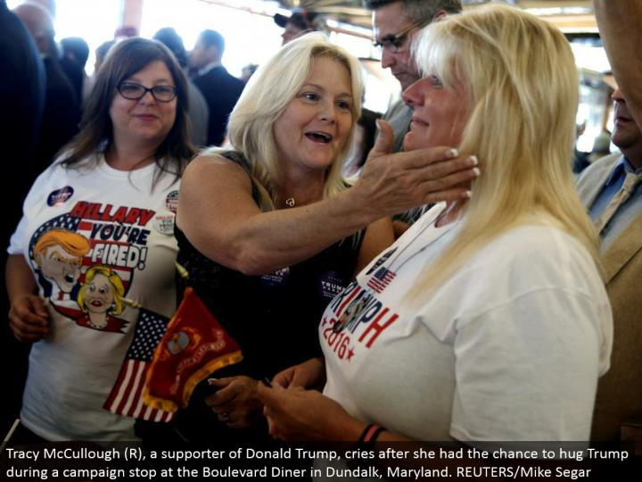 Tracy McCullough (R), a supporter of Donald Trump, cries after she had the opportunity to embrace Trump amid a crusade stop at the Boulevard Diner in Dundalk, Maryland. REUTERS/Mike Segar