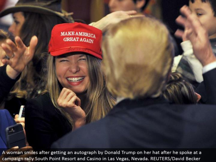 A lady grins in the wake of getting a signature by Donald Trump on her cap after he talked at a battle rally South Point Resort and Casino in Las Vegas, Nevada. REUTERS/David Becker