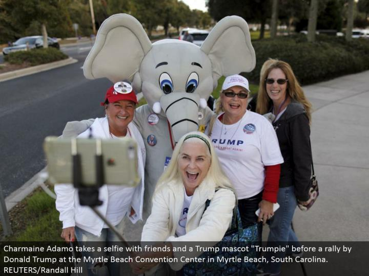 "Charmaine Adamo brings a selfie with companions and a Trump mascot ""Trumpie"" before a rally by Donald Trump at the Myrtle Beach Convention Center in Myrtle Beach, South Carolina. REUTERS/Randall Hill"