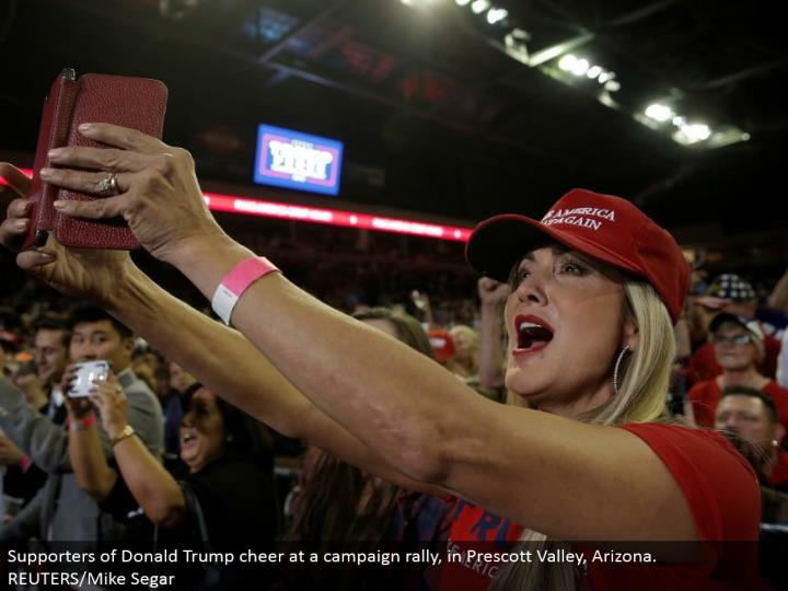 Supporters of Donald Trump cheer at a crusade rally, in Prescott Valley, Arizona. REUTERS/Mike Segar