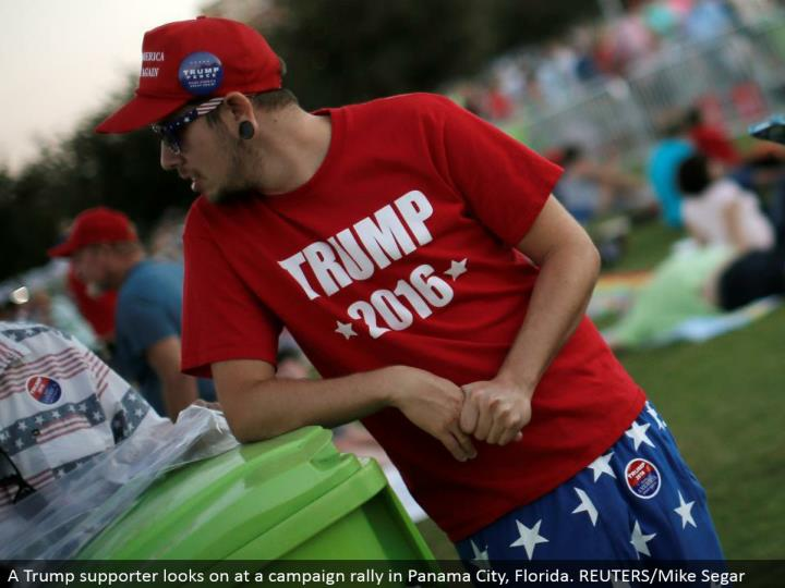 A Trump supporter looks on at a battle rally in Panama City, Florida. REUTERS/Mike Segar